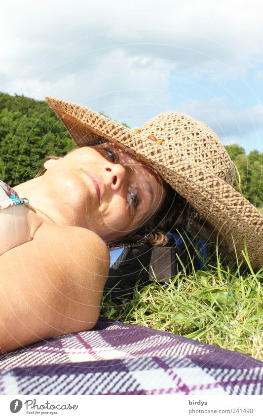 drift Contentment Relaxation Summer vacation Sunbathing Young woman Youth (Young adults) Face 1 Human being 18 - 30 years Adults Nature Sky Clouds Hat straw hat