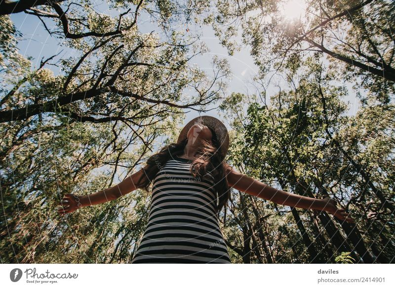 Cute woman with opened arms in nature Woman Human being Nature Vacation & Travel Youth (Young adults) Young woman Green Tree Forest Adults Lifestyle Environment