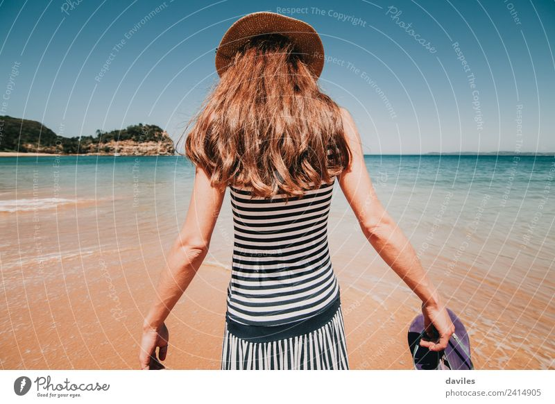 Woman in her back walking into the beach water Human being Sky Nature Vacation & Travel Youth (Young adults) Summer Blue Water Landscape White Ocean Beach