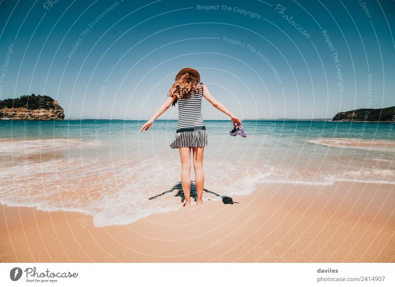 Woman with a dress and a hat walking into the beach water in Maitland bay, NSW, Australia. Lifestyle Vacation & Travel Tourism Adventure Beach Ocean Human being