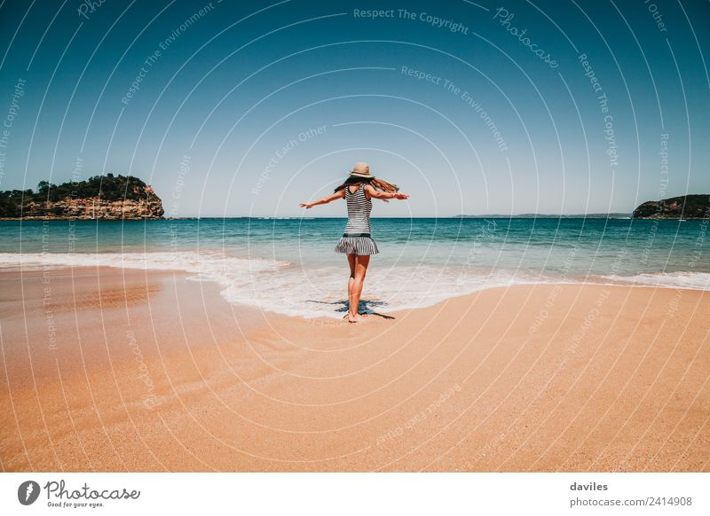 Cute woman dancing in the sea shore Human being Sky Nature Vacation & Travel Youth (Young adults) Young woman Summer Blue Beautiful Landscape Ocean Relaxation