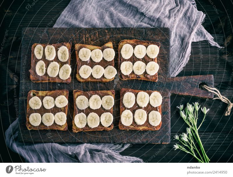 French toasts with chocolate Fruit Bread Dessert Candy Nutrition Breakfast Flower Wood Eating Fresh Delicious Above Brown Tradition french Banana background