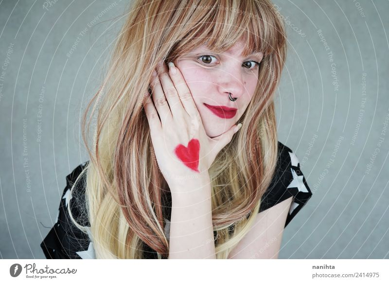 Young blonde woman with a heart painted in her hand Style Design Joy Beautiful Hair and hairstyles Healthy Wellness Senses Valentine's Day Human being Feminine