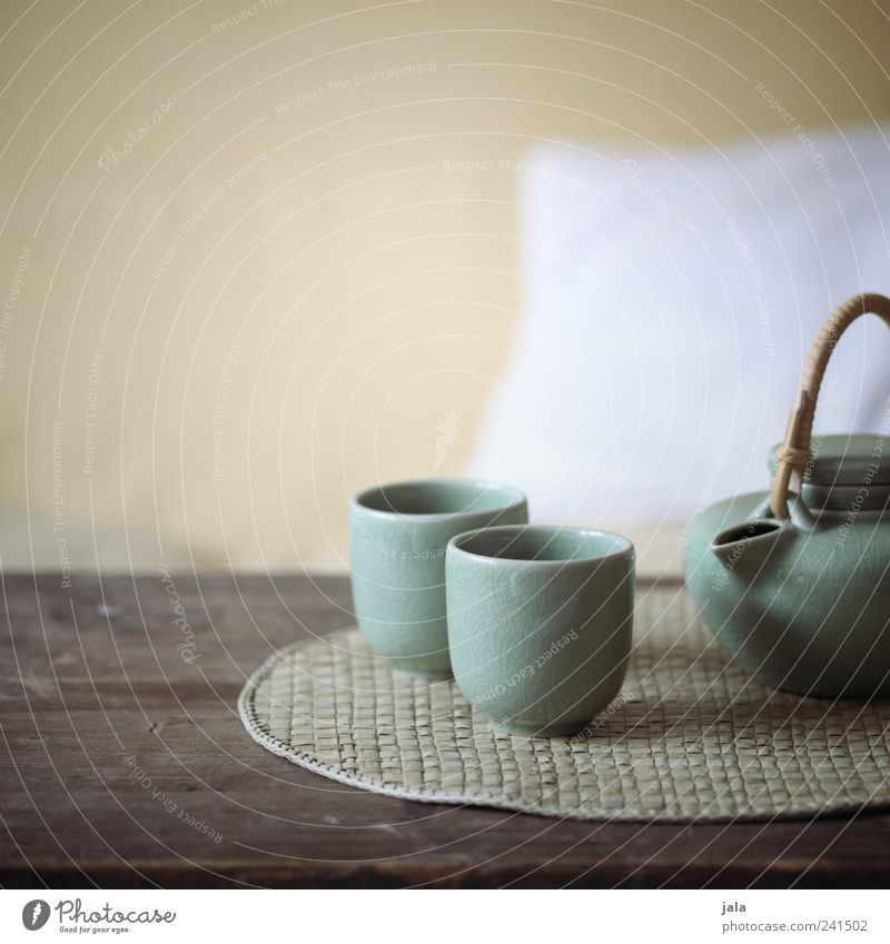 tee Beverage Hot drink Tea Crockery Teapot Living or residing Flat (apartment) Armchair Table Relaxation Interior shot Deserted Copy Space top Day