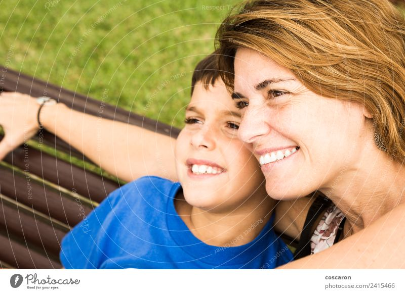 Mother and son seated on a park Woman Child Nature Beautiful White Joy Adults Lifestyle Love Family & Relations Boy (child) Happy Small Together Park Infancy