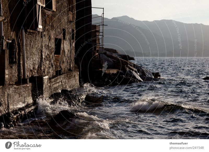 Old Ocean Summer Vacation & Travel House (Residential Structure) Far-off places Window Wall (building) Mountain Architecture Coast Wall (barrier) Moody Brown Waves Rock
