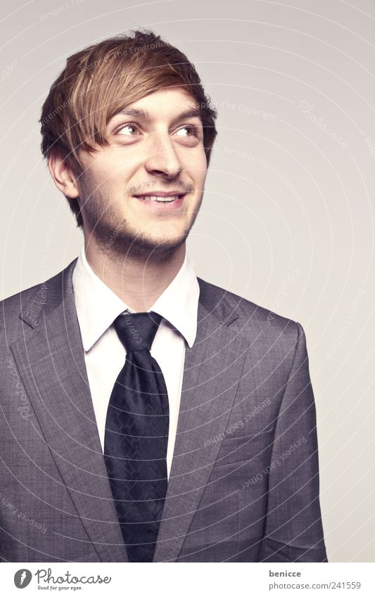 shyguy Man Human being Businesspeople Portrait photograph Laughter Smiling Looking Sideways To one side Tie Suit Isolated Image Reliability Timidity Joy Success
