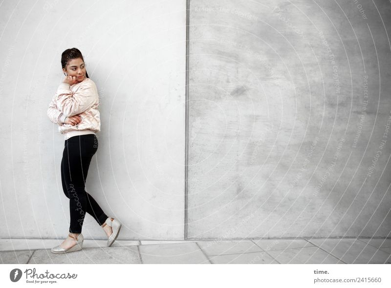 Nikoliya Feminine Woman Adults 1 Human being Wall (barrier) Wall (building) Pants Jacket Sneakers Brunette Long-haired Observe Think To hold on Going Looking