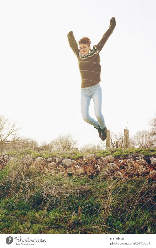 Young and happy woman having fun and jumping outdoors Human being Nature Vacation & Travel Youth (Young adults) Young woman Summer Beautiful Sun Joy
