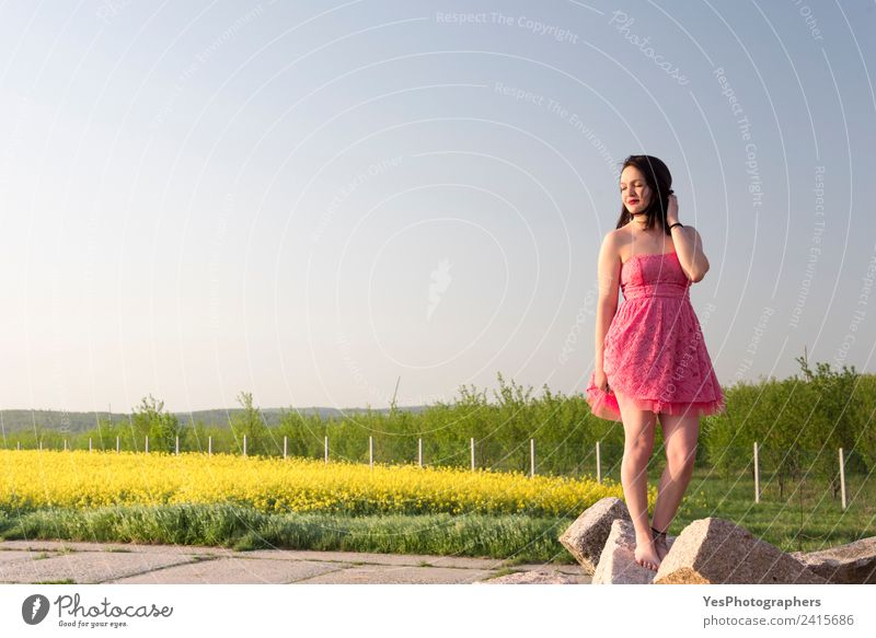 Woman in a pink dress at sunset Nature Vacation & Travel Summer Beautiful Green Relaxation Calm Adults Yellow Meadow Happy Elegant Smiling Happiness To enjoy