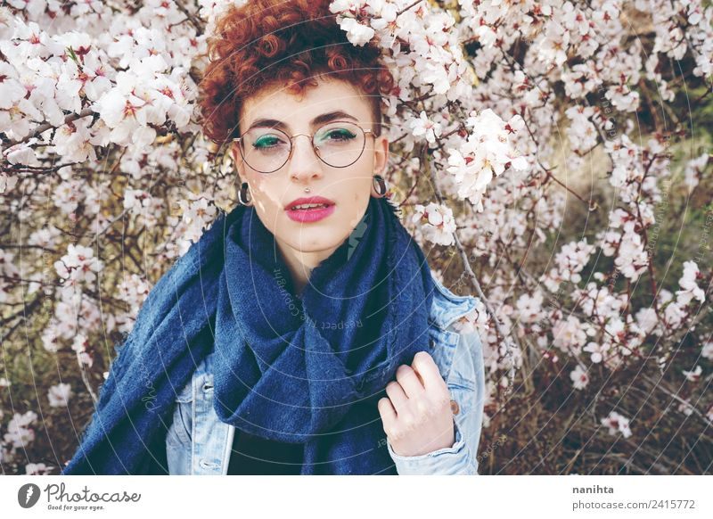 Beautiful redhead woman surrounded by flowers in spring Lifestyle Style Hair and hairstyles Skin Face Wellness Senses Fragrance Human being Feminine Young woman