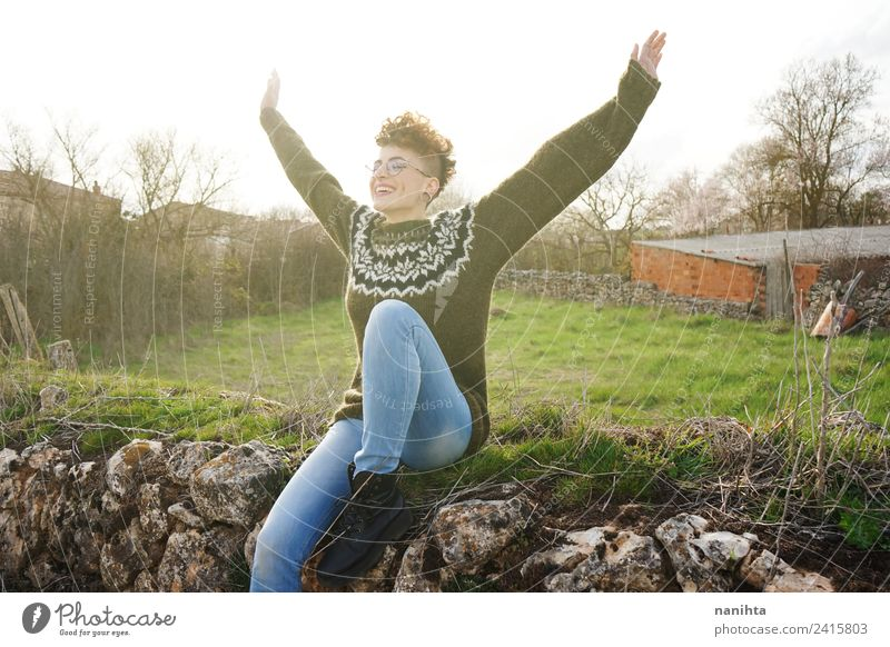 Young happy and free woman in a rural scene Lifestyle Style Joy Healthy Wellness Harmonious Well-being Senses Vacation & Travel Adventure Freedom Sun