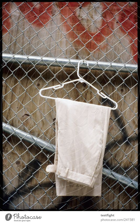 Wall (building) Graffiti Fashion Wait Clothing Cloth Pants Fence Hang Hanger Wire netting fence