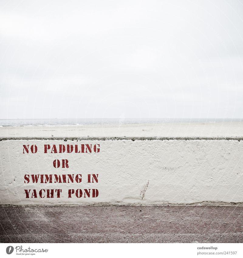 grey summer day Wall (barrier) Wall (building) Characters Signs and labeling Signage Warning sign Bans Typography English North Sea coast England Beach Horizon