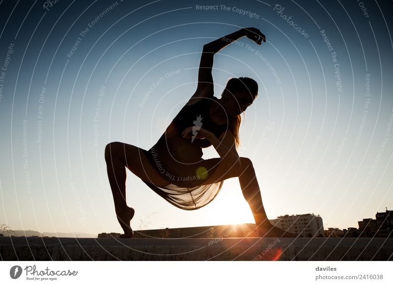 Woman moving and dancing ballet against a blue sky, forming a silhouette. Lifestyle Joy Body Summer Sun Dance Fitness Sports Training Human being Young woman