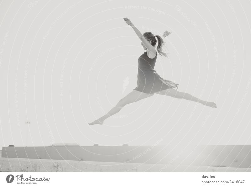 Classic dance jump. Woman Human being Sky Youth (Young adults) Beautiful Sun 18 - 30 years Black Street Adults Sports Freedom Jump Modern Power Action