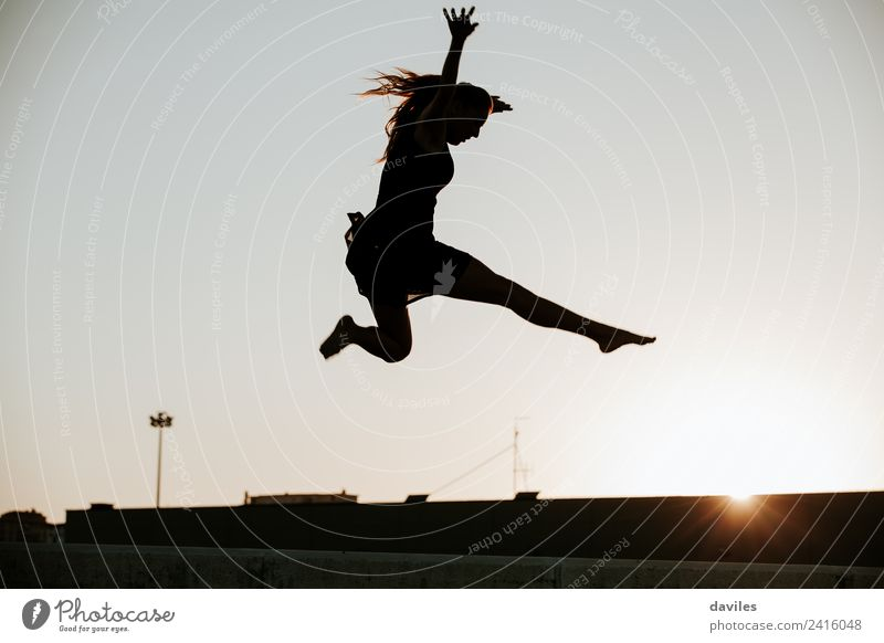 Woman jumping in the air silhouette Human being Sky Youth (Young adults) Young woman Town Beautiful 18 - 30 years Black Adults Wall (building) Sports Feminine
