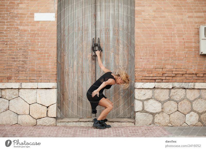 White blonde woman performing contemporary dance in the street. Lifestyle Elegant Style Sports Fitness Sports Training Human being Young woman