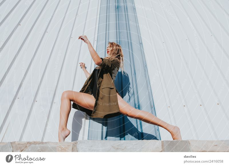 Cool woman posing in front of a wall Lifestyle Sports Fitness Sports Training Dance Human being Woman Adults 1 18 - 30 years Youth (Young adults) Artist Dancer