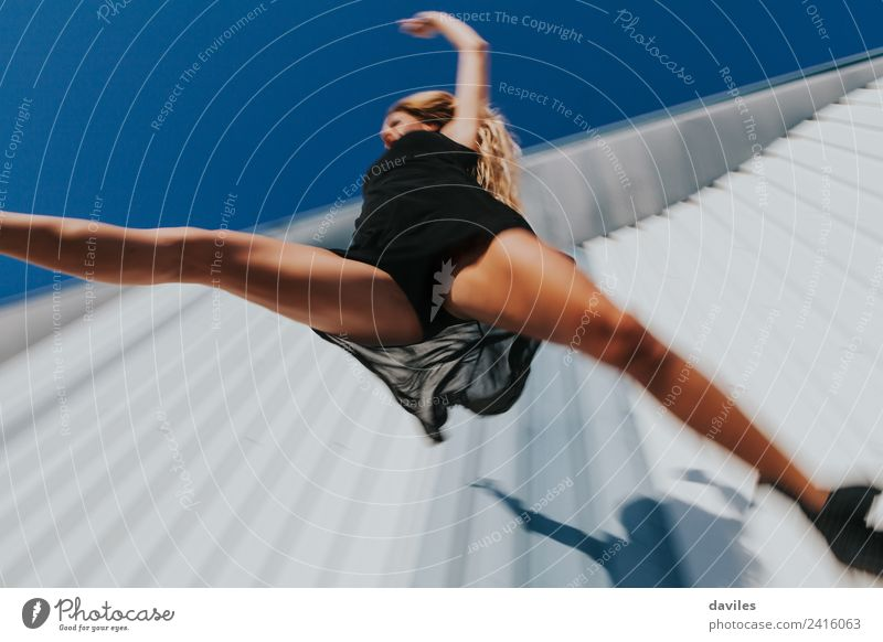 Low angle view of woman in black dress jumping Lifestyle Elegant Dance Sports Fitness Sports Training Human being Feminine Young woman Youth (Young adults)