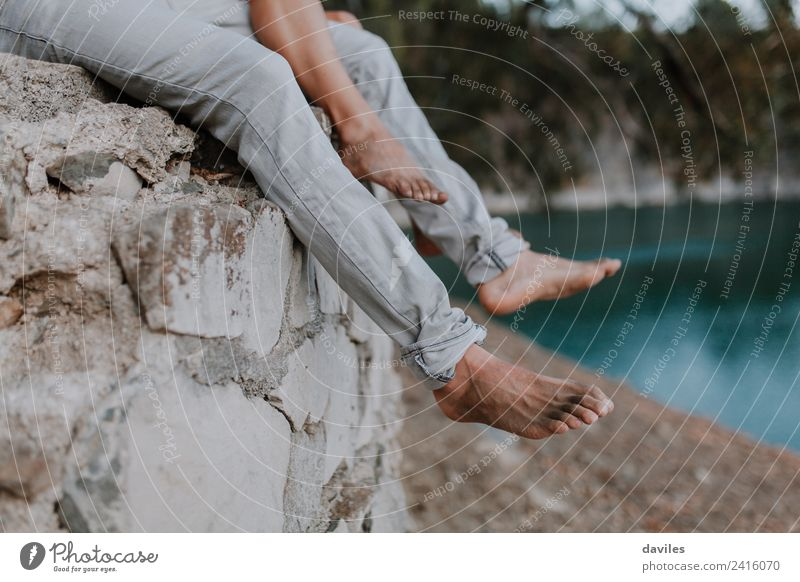Man and woman legs hanging from a wall Woman Human being Nature Vacation & Travel Blue White Relaxation Black Adults Lifestyle Legs Love Feet Couple Stone