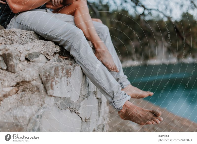 Couple legs hanging from a wall barefoot. Woman Human being Nature Vacation & Travel Youth (Young adults) Man Summer Blue Beautiful White Ocean Beach Forest