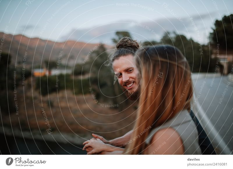 Bearded man smiling with his girlfriend. Lifestyle Joy Beautiful Summer Human being Woman Adults Man Couple 2 18 - 30 years Youth (Young adults) Nature Forest