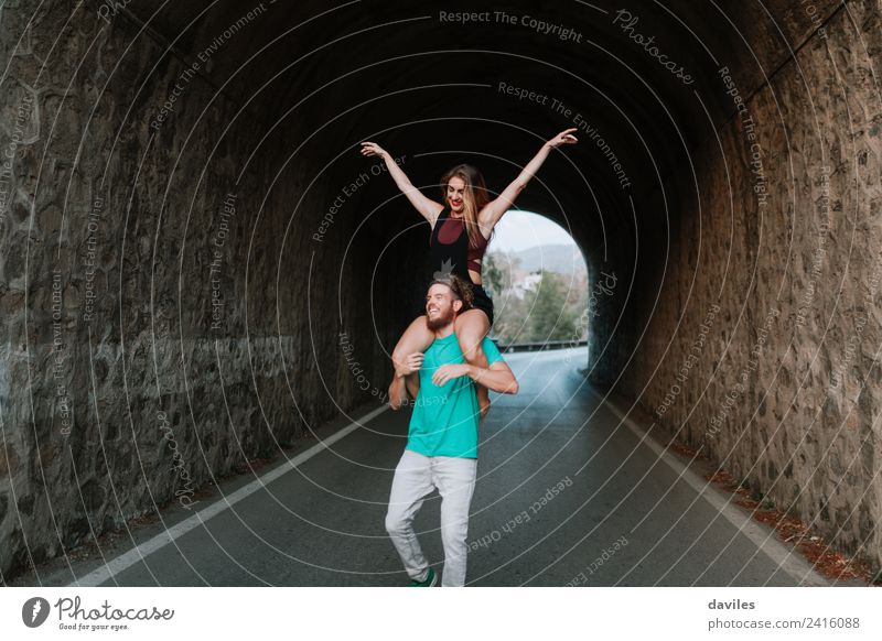 Happy young couple having fun together Woman Human being Vacation & Travel Man Joy Street Adults Lifestyle Love Couple Stone Copy Space Smiling Action Happiness