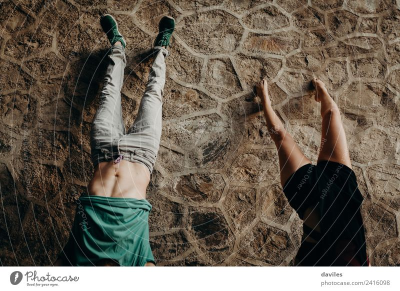 Young couple doing a handstand Joy Beautiful Vacation & Travel Human being Woman Adults Man Couple 2 18 - 30 years Youth (Young adults) Forest Tunnel Stone