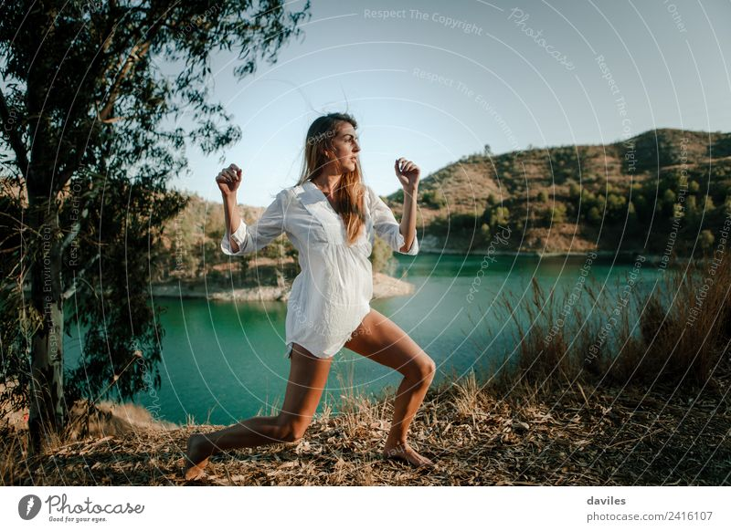 Woman posing in nature with a lake in the background Human being Nature Youth (Young adults) Summer Beautiful Green Sun White Forest Mountain 18 - 30 years