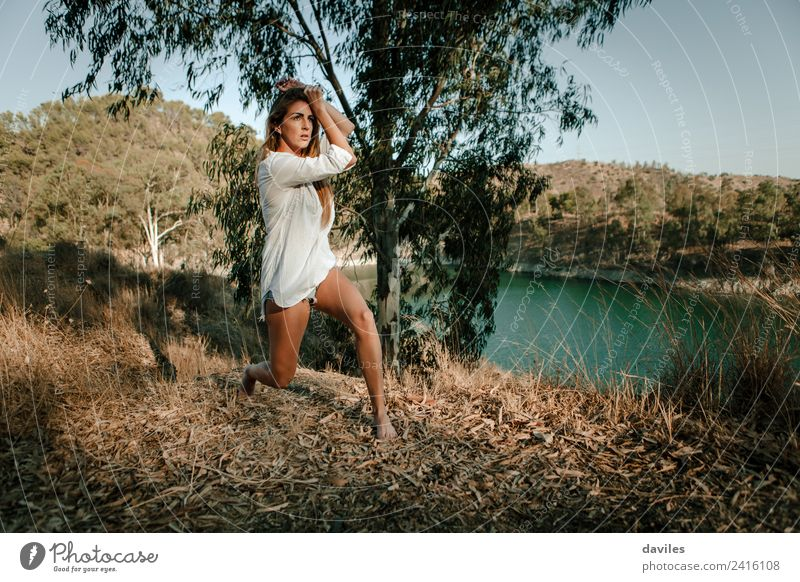 Woman performing contemporary dance outdoors Human being Nature Youth (Young adults) Summer Sun White Forest Mountain 18 - 30 years Adults Lifestyle Natural