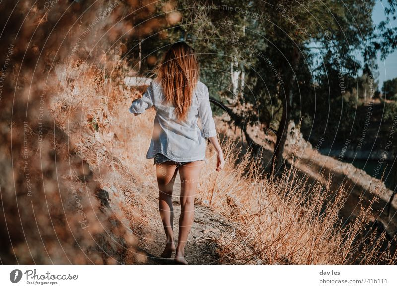 Barefoot woman walking along narrow path in nature. Lifestyle Mountain Hiking Human being Woman Adults 1 18 - 30 years Youth (Young adults) Nature Landscape