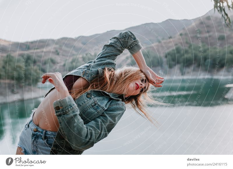 Woman in shorts and jacket posing in nature Lifestyle Style Beautiful Face Mountain Human being Adults 1 18 - 30 years Youth (Young adults) Dancer Youth culture