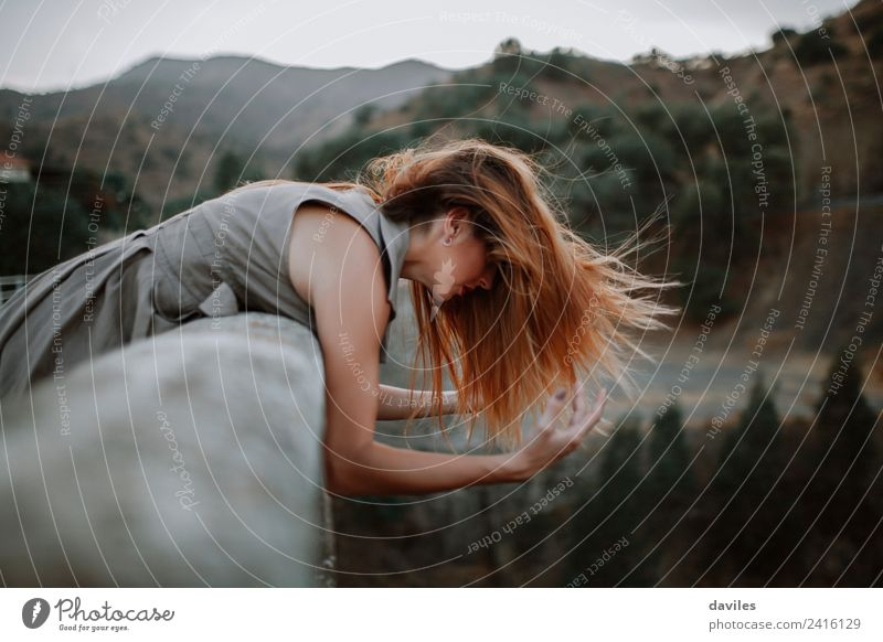 Woman leaning out in a bridge while wind moves her hair. Lifestyle Beautiful Vacation & Travel Tourism Human being Adults 1 18 - 30 years Youth (Young adults)