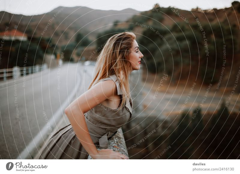 Cute blonde woman peeking on a bridge at the road. Lifestyle Beautiful Vacation & Travel Tourism Human being Feminine Woman Adults 1 18 - 30 years