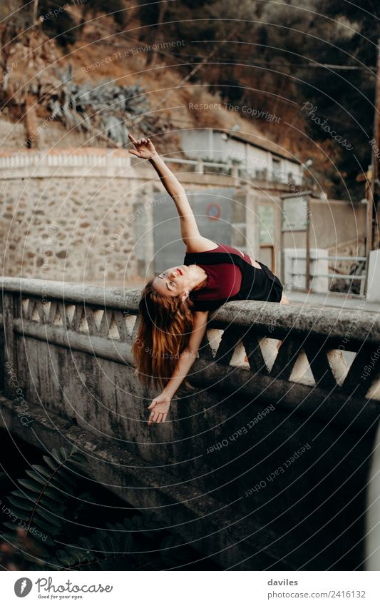 Blonde woman leaning out on a bridge with open arms, dancing. Lifestyle Beautiful Vacation & Travel Tourism Human being Feminine Woman Adults 1 18 - 30 years