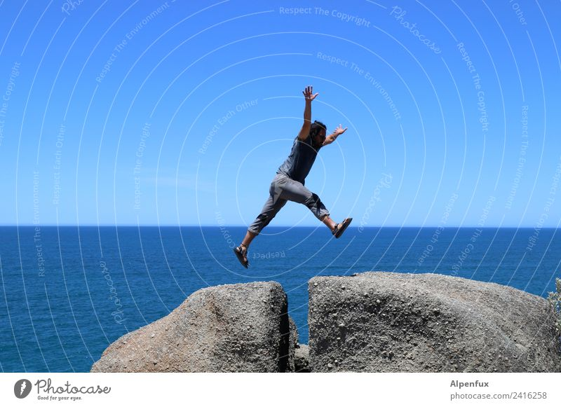 Human being Man Ocean Joy Adults Movement Freedom Rock Jump Masculine Success Adventure Joie de vivre (Vitality) Energy Tall Athletic