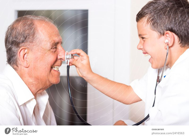 Kid examines his grandfather using stethoscope Face Health care Illness Medication Playing Child Profession Doctor Hospital Career Human being Boy (child)