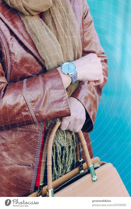 Woman wearing leather coat silver wristwatch holding handbag Human being Youth (Young adults) Young woman Hand 18 - 30 years Adults Lifestyle Style Fashion