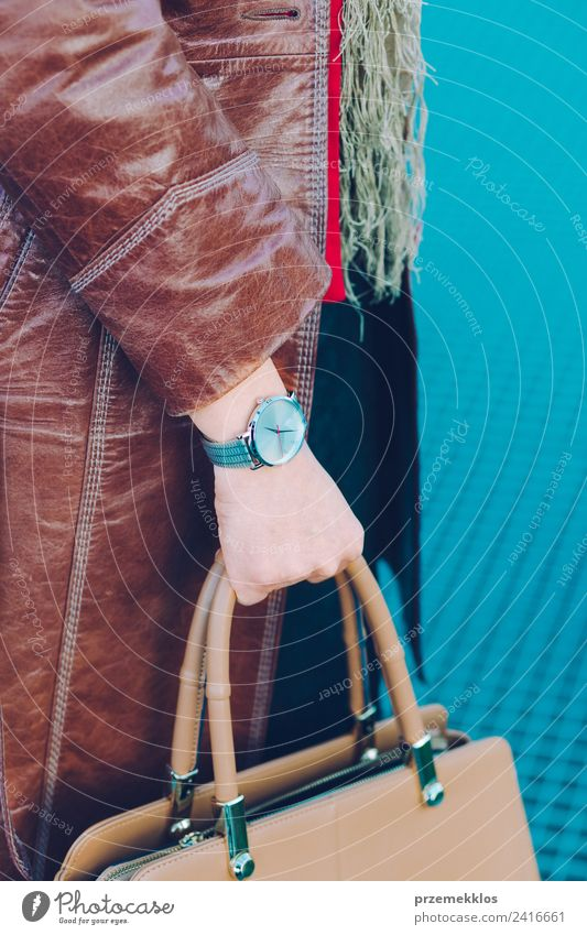 Woman wearing leather coat silver wristwatch holding handbag Human being Youth (Young adults) Young woman 18 - 30 years Adults Lifestyle Style Fashion Clock