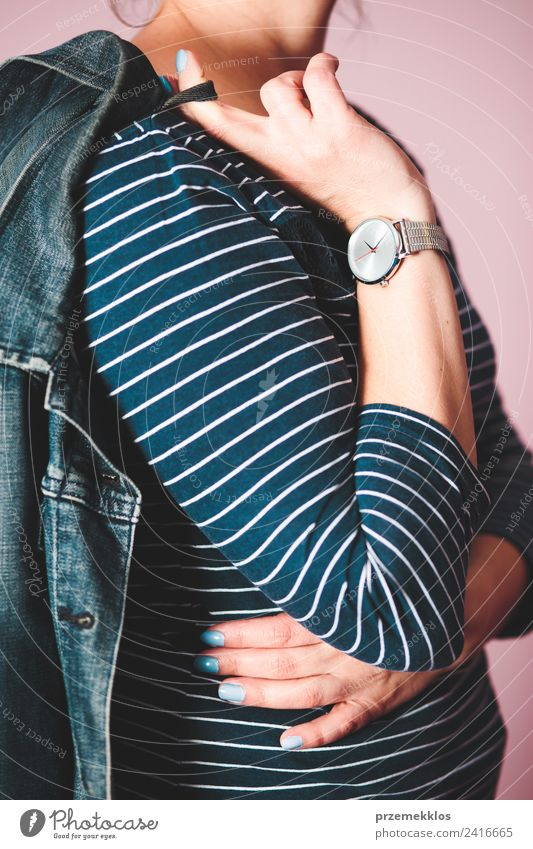 Woman wearing jeans jacket, blue blouse and silver wristwatch Lifestyle Style Clock Human being Young woman Youth (Young adults) Adults Body 1 18 - 30 years