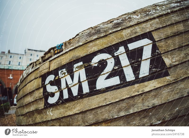 old fishing boat on the beach Environment Esthetic Brighton Navigation Watercraft Fishing boat Digits and numbers Name Denote England Ocean Beach Harbour Old