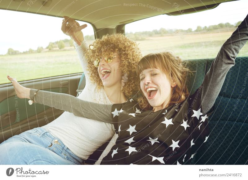 Two cheerful friends in a road trip Lifestyle Style Joy Wellness Vacation & Travel Tourism Trip Adventure Freedom Human being Feminine Young woman