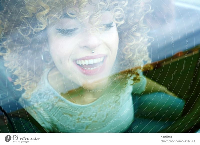 Young happy woman looking through a car window Lifestyle Style Design Joy Beautiful Hair and hairstyles Skin Face Wellness Leisure and hobbies Vacation & Travel