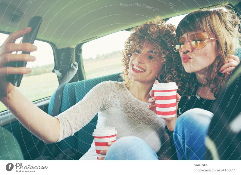 Two young friends taking a selfie and drinking coffee Human being Vacation & Travel Youth (Young adults) Young woman Joy 18 - 30 years Adults Lifestyle Feminine