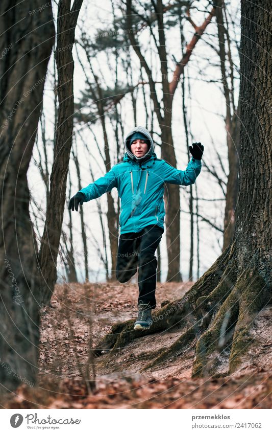 Young man running outdoors during workout in a forest Human being Nature Youth (Young adults) Man Blue Tree Relaxation Joy Winter Forest Adults Lifestyle Autumn