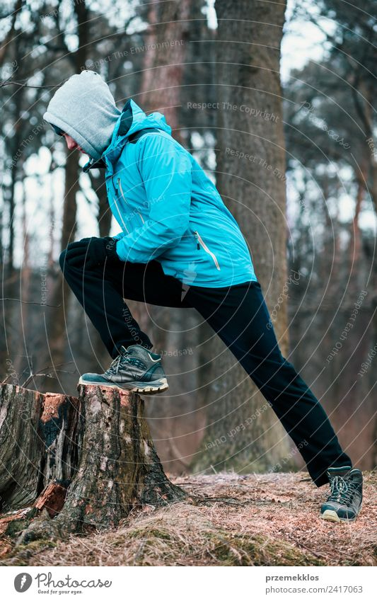 Young man exercising outdoors in a forest Human being Nature Youth (Young adults) Man Tree Relaxation Winter Forest Adults Lifestyle Autumn Sports Movement