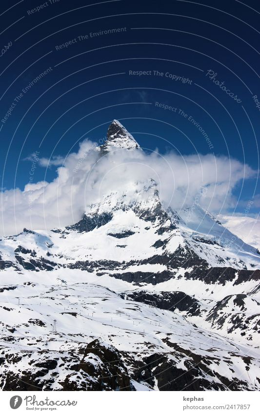 Matterhorn in clouds Nature Landscape Sky Clouds Winter Snow Rock Alps Mountain Peak Snowcapped peak Zermatt Switzerland Deserted Landmark Hiking Esthetic