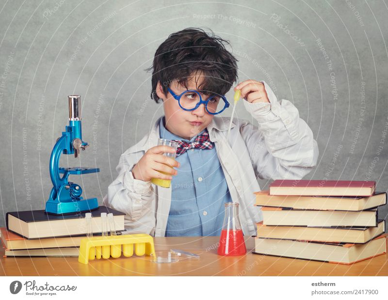 boy is making science experiments in a laboratory Child Human being Lifestyle Emotions Boy (child) Masculine Infancy Creativity Study Observe Curiosity