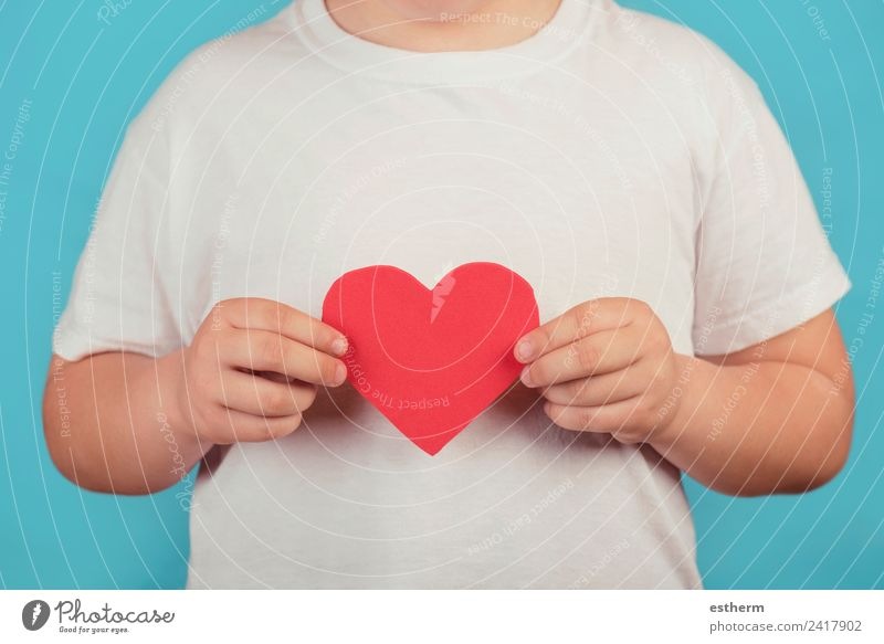 boy with a heart on blue background Lifestyle Joy Feasts & Celebrations Valentine's Day Mother's Day Human being Masculine Child Toddler Boy (child) Infancy 1